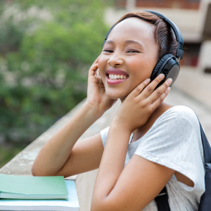 african female university student listening to music