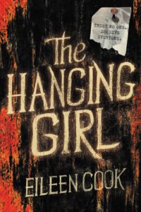 """The Hanging Girl cover image: red and black with title and a pinned note that reads """"trust no one deceive everyone"""""""
