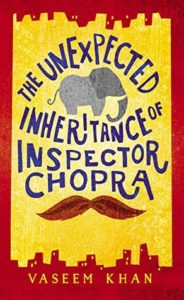 The Unexpected Inheritance of Inspector Chopra cover design: yellow with red border with an elephant between title words and a mustache at the bottom