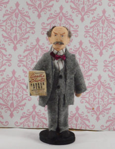 a handpainted and sewn standing doll of Agatha Christie's character Parker Pyne