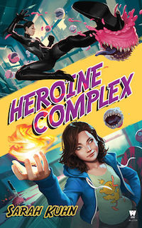 there are two young asian women. one has her hair in a ponytail and is wearing a black catsuit, kicking a cupcake with teeth. the other is wearing a hoodie and a tshirt and holds a ball of fire in her right hand.