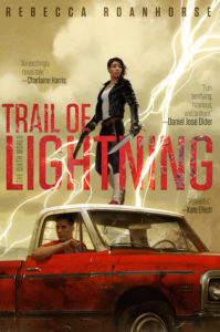 cover image: a young native american woman in a leather jacket holding a sword standing on top of a pickup truck with a young man inside and lightning in the sky behind