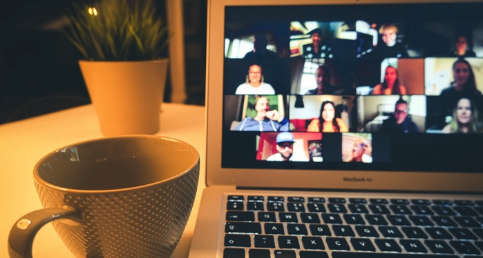 image of a laptop screen showing a group video call https://unsplash.com/photos/fRGoTJFQAHM